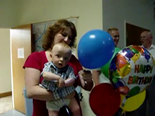 6/29/08 -  Luke playing with his birthday ballons with his aunt Bobo.
