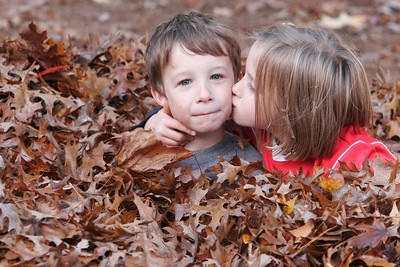 Reece and Reagan playing in a leaf pile--Nov. 15, 2008