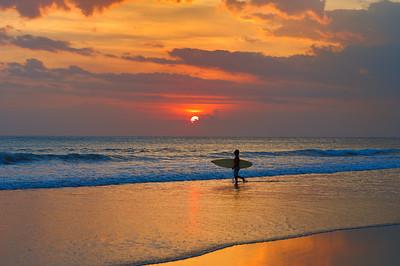 Surfer at sunset. Kudeta, Seminyak, Bali