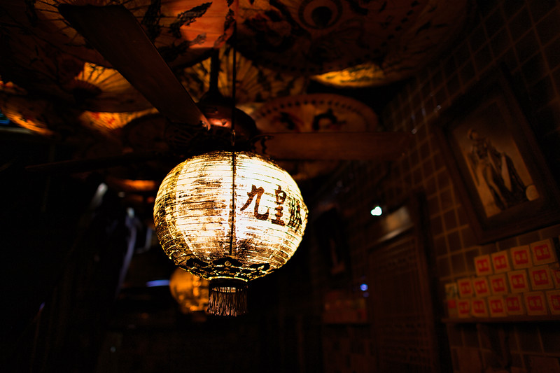 Inside Maggie Choo's night club in Bangkok. Chinese lanterns and upside down umbrellas