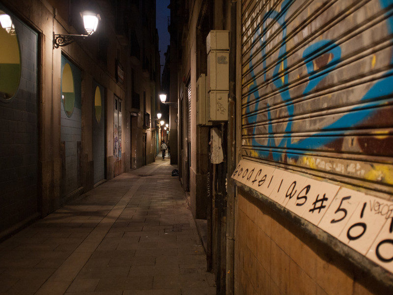 A common feature of the city, dimly lit alleyways.
