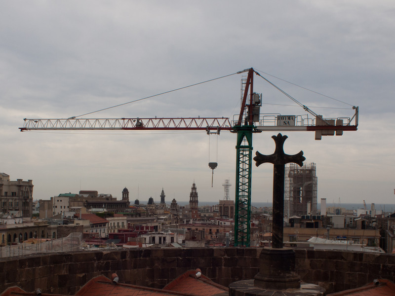 On the roof of the cathedral, the cross of the church being replicated by the crane, signifies something in my mind I am sure, but not sure what.