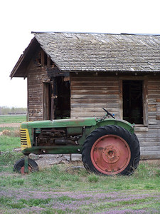 Abandoned homestead with tractor