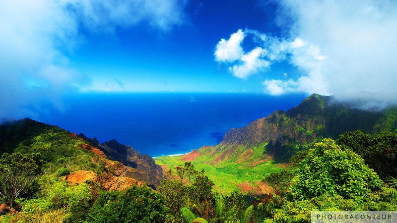 """Koke'e Panoramic"" ~ Panoramic photo of the majestic Kalalau Valley from the Pu'u-o-Kila Lookout in Kauai's Koke'e State Park.  Waves crash along the Nāpali Coast 4176 feet below as clouds hover over the Ka'a'alahina Ridge.  <hr> <p></p> <b>HUGE PRINTS are also available for this photo! Get prints that are taller than you are, or wider than you can stretch your arms! Click for more info:</b> <p></p> <p><a href=""http://LTLprints.com/PhotoRaconteur"" ><img src=""http://photoraconteur.com/LTL.png"" border=0  /></a><p>"