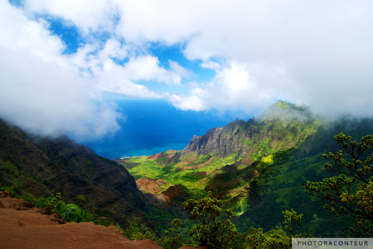 """Kalalau Valley Vista"" ~ View of the Kalalau Valley from the Pu'u-o-Kila Lookout in Kauai's Koke'e State Park.  Waves crash along the Nāpali Coast 4176 feet below as clouds hover over the Ka'a'alahina Ridge."