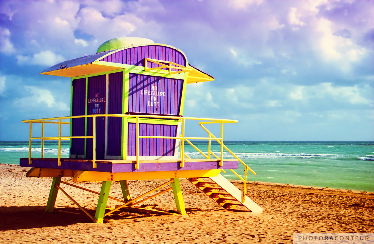 """Lifeguard Tower at 12th Street"" ~ I've had few beach experiences as enjoyable as my early morning strolls on South Beach in Miami, Florida.  The extra-wide soft sand beach bordered by the bright turquoise waters and adorned with colorful, unique lifeguard towers make it unforgettable, not to mention the impeccable Art Deco hotels, vibrant nightlife and diversity of people in the area.  My favorite tower shown here is located at the end of 12th Street and is one of a few that still stands after Hurricane Wilma hit South Beach with destructive forces in 2005.  All of the towers that were destroyed have since been replaced with new towers that are also vibrant, unique, and awaiting the glance of my camera on an overdue return visit.    NOW AVAILABLE: 16""x24"" MetalPrints in Limited Editions of 100. Click for more info:      HUGE PRINTS are also available for this photo! Get prints that are taller than you are, or wider than you can stretch your arms! Click for more info:"