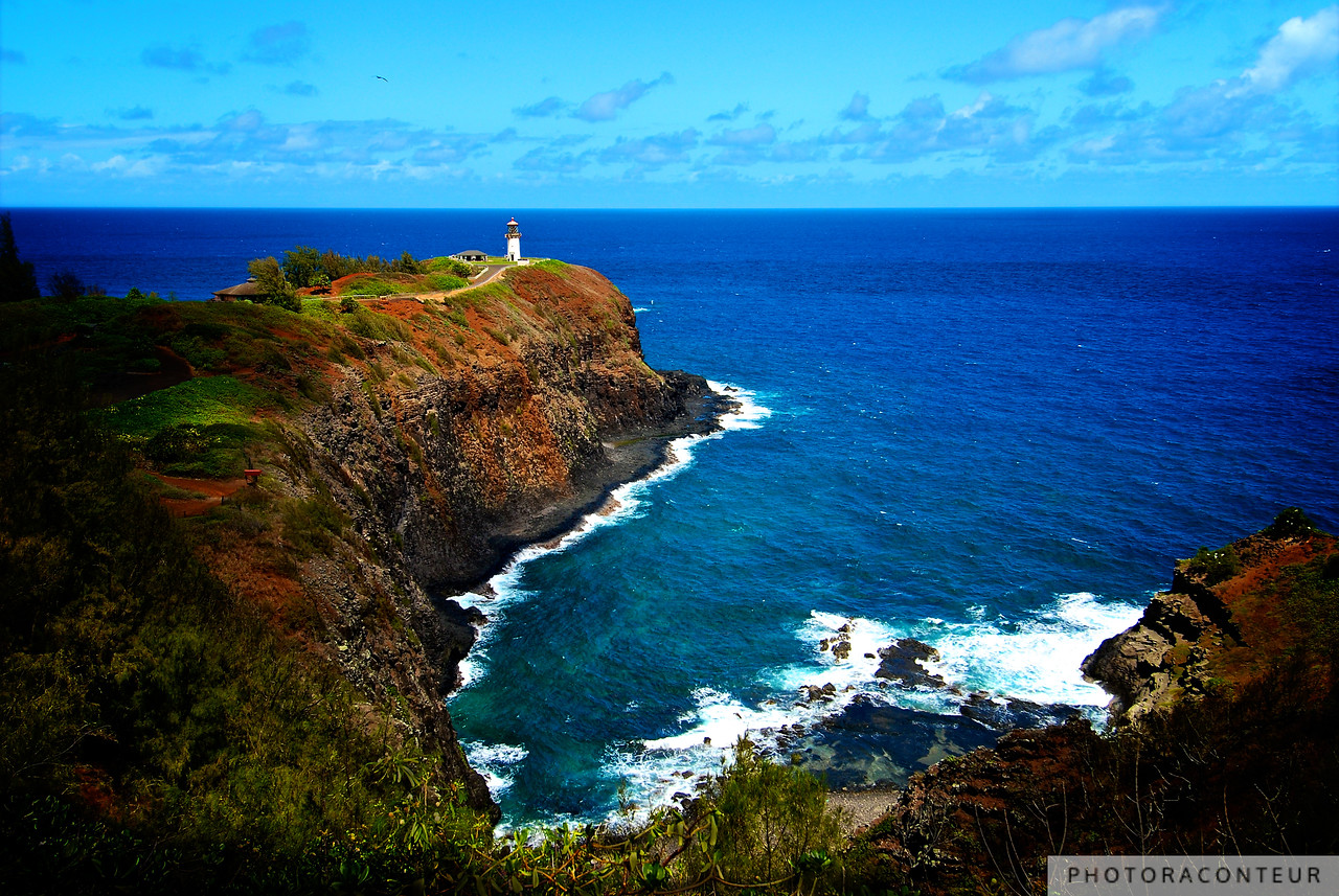 """Kilauea Lighthouse, Kauai"" ~ Kilauea Lighthouse on the north shore of Kauai began lighting the way for mariners in 1913. It served as a pivotal navigation aid for ships sailing on the Orient run before it was decommissioned in 1976.  The ocean cliffs and open grassy slopes of an extinct volcano also provide breeding grounds for native Hawaiian seabirds and nene, the endangered Hawaiian goose.  The lighthouse site is now managed as part of the 203-acre Kilauea National Wildlife Refuge."