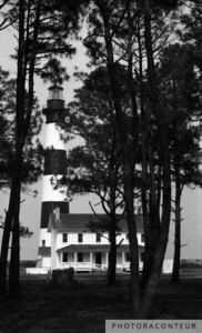"""Bodie Island Lighthouse"" ~ Through the trees appears the historic Bodie Island Lighthouse, located along the Outer Banks of North Carolina."