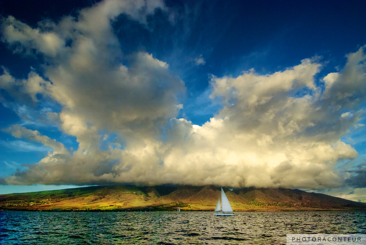 """Maui Sailboat Cloudscape"" ~ In the late summer of 2010, my wife and I had the fortune of staying on West Maui for several days.  One evening we ventured out a sailboat cruise to enjoy the sunset along with a few cocktails.  I really wasn't planning to take many photographs, but when I noticed how the setting sun was lighting up the spectacular clouds that were virtually exploding above the island of Maui, I instantly knew that I was experiencing a special moment that I needed to capture.   NOW AVAILABLE: 16""x24"" MetalPrints in Limited Editions of 100. Click for more info:      HUGE PRINTS are also available for this photo! Get prints that are taller than you are, or wider than you can stretch your arms! Click for more info:"