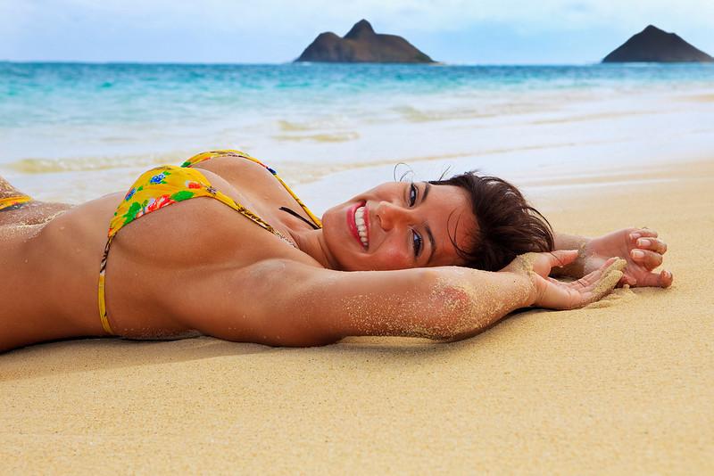 beautiful girl in a yellow bikini at the beach in Hawaii