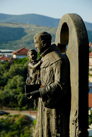 Statue of St. Francis holding a child in front of a church on the island of Čiovo not far from Trogir.