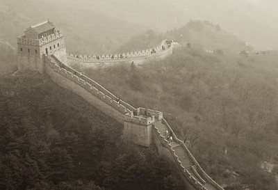 Wall towers in dense fog.
