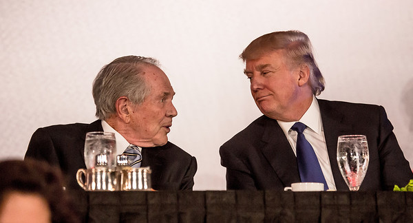Pat Robertson and Donald Trump chat during dinner