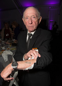 "Survivor Henry Flescher (89) shows off his tattoo. During the Holocaust, concentration camp prisoners received tattoos only at one location, the Auschwitz concentration camp complex.  He was born in Vienna Austria and initially escaped to France where he was eventually interred in Drancy deportation camp, a place where Jews, Gypsies, and others were held before being shipped to the German concentration camps. On the matter of the Vichy French, Henry simply says ""Petain gave me to Eichmann""."