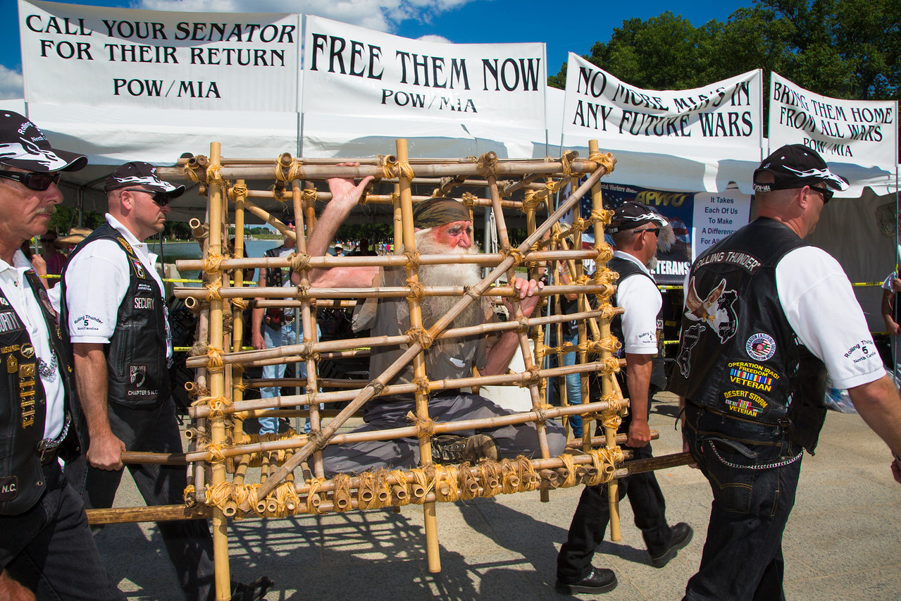 Rolling Thunder veteran Gerald McCullar demonstrates as a POW trapped in a Tiger Cage to express his solidarity with his comrades who never returned from Southeast Asia<br /> <br /> Rolling Thunder XXVII (2014) (5-25-14)