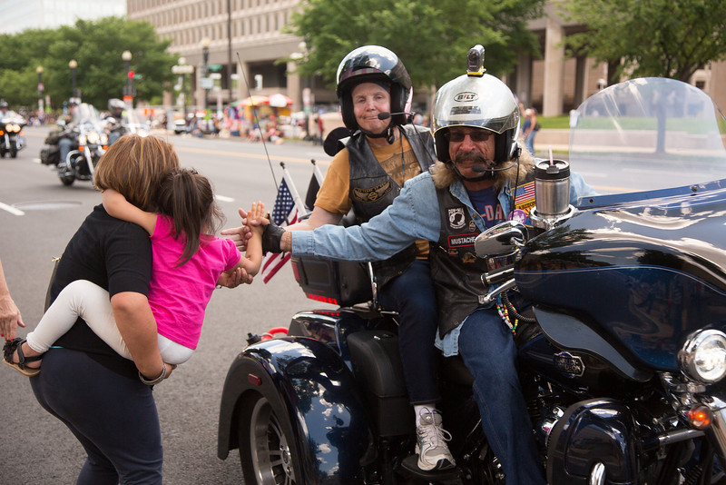 Izabella, age 3 1/2 from Germantown, Md., gets a high five from passing cyclists.<br /> <br /> Rolling Thunder XXVII (2014) (5-25-14)