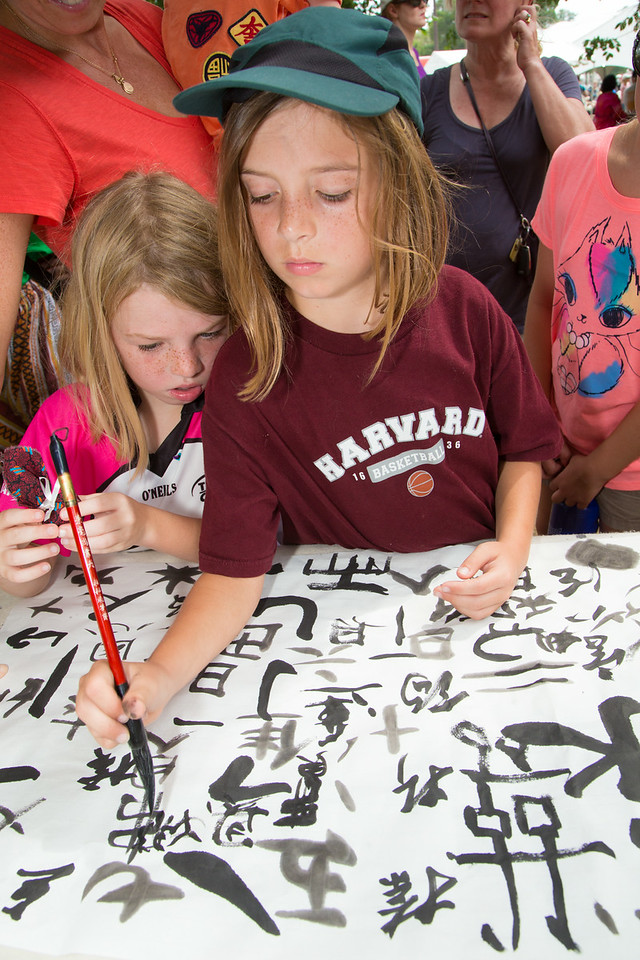Fiona (age 9) (right) practices Chinese calligraphy while Teagan (7) looks on at the Smithsonian Folklife Festival on July 3.