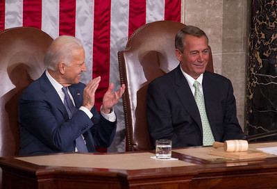 """Vice President Joe Biden applauds Speaker John Boehner (R-OH) as President Barack Obama saluted Boehner's life journey from """"the son of a barkeep to Speaker of the House"""". President Barack Obama delivered his fifth State of the Union Address before a joint session of Congress in the House Chamber at the U.S. Capitol in Washington D.C. on January 28, 2014"""