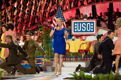 Megan Hilty on the stage performing a medley of songs from the WWII era.