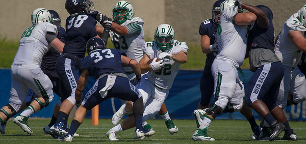 Ryder Stone (32) with the ball for Dartmouth. The Big Green of Dartmouth (1-0) defeated the Georgetown Hoyas (1-2) 31-10 in football action in front of a sold out crowd at Multi-Sport Field on the Georgetown University campus in Washington D.C. on Saturday, September 19, 2015.