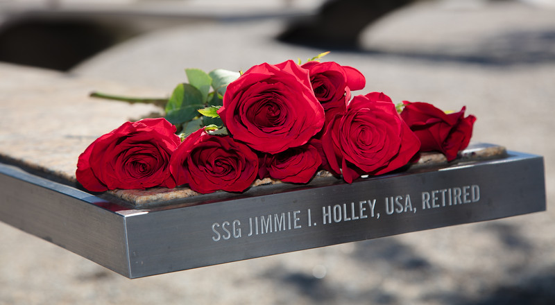 Memorial Service in Remembrance of 9/11on Sept. 11, 2015. The Pentagon Memorial, located just southwest of The Pentagon in Arlington County, Virginia, is a permanent outdoor memorial to the 184 people who died as victims in the building and on American Airlines Flight 77 during the September 11 attacks.