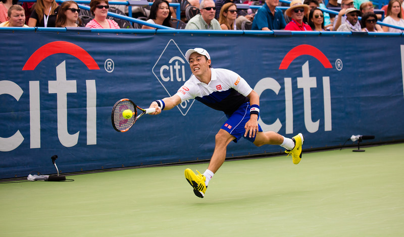Kei Nishikori of Japan, ranked fourth in the world, chases down a volley at the Citi Open Tennis Tournament in Washington D.C. on August 7, 2015.