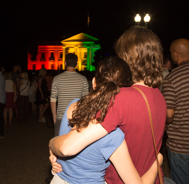 Monica Martinez of Washington D.C. (left) and Alisha Sutton of Springfield VA were among the hundreds gathered in celebration in front of the White House which was lit up in rainbow colors in recognition of the U.S. Supreme Court's ruling in favor of legalizing same-sex marriage on Friday, June 26, 2015 in Washington D.C.