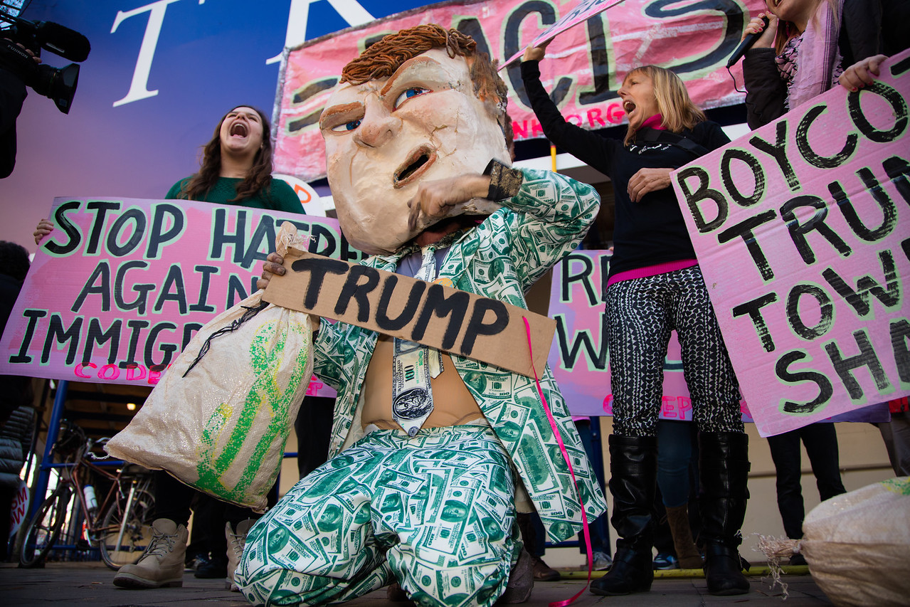 """Donald Trump impersonator Tighe Barry led pro-refugee activists in front of the Trump International Hotel on Pennsylvania Ave. in Washington D.C., on Thursday, December 10, 2015, in a protest against Republican presidential candidate Donald Trump, calling for a boycott of the hotel which is set to open in 2016. The demonstration was organized by the activist group """"Code Pink"""". On Monday, Trump, the current leader in the race for the GOP nomination, called for a temporary ban of all Muslims entering the U.S., a move which received widespread condemnation."""