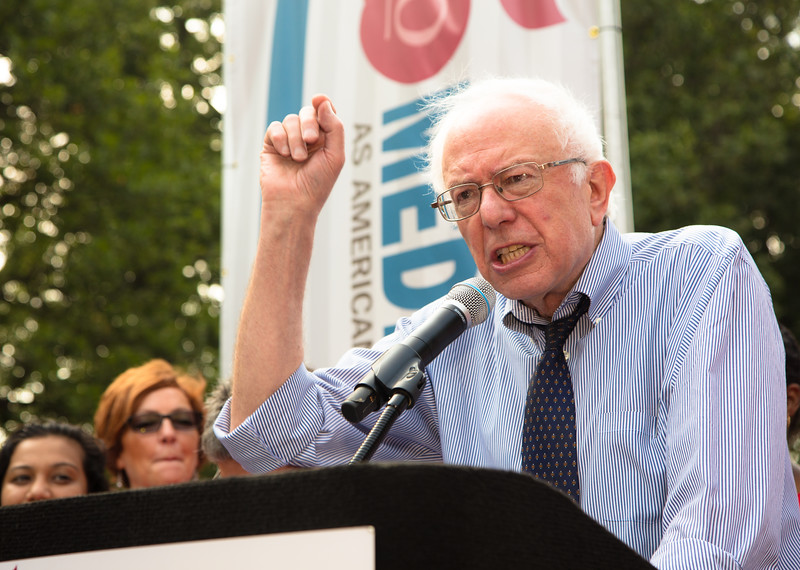 "Presidential candidate Sen. Bernie Sanders (I-VT) was the featured speaker at a rally celebrating Medicare's 50th Anniversary at Upper Senate Park on Capitol Hill in Washington, D.C. on Thursday July 30, 2015. He was joined  with other legislators, registered nurses and community members. The event was part of a national day of action, in over 25 U.S. cities, that called on policy makers to ""Protect, Improve, and Expand"" Medicare to cover all Americans with a single standard of quality care not based on ability to pay, under a theme of ""Medicare is as American as Apple Pie."" The coalition organizing the day of action included: National Nurses United, Physicians for a National Health Program, Alliance for Retired Americans, Campaign for a Healthy California, Healthcare-NOW!, Progressive Democrats of America, among others."