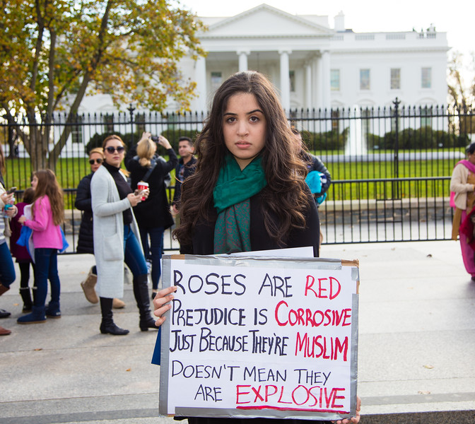 """""""Prejudice is corrosive"""" declares Zainab Feroze of Roswell NM. Chanting """"Let them in"""", hundreds of demonstrators rallied outside the White House in support of allowing Syrian refugees to enter the United States. The rally in Washington D.C. took place on Saturday, November 21, 2015. President Barack Obama has planned to allow 10,000 Syrian refugees to enter the United States. Earlier in the week, the U.S. House of Representatives had voted to make it harder for them to do so because of concerns that terrorists could pose as refugees and carry out attacks similar to those that recently took place in Paris. In addition, more than half of the country's governors have said they will no longer provide placement for the refugees."""