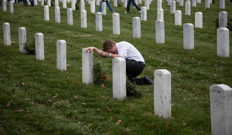 Thousands gathered at Arlington National Cemetery in Arlington Va. on Saturday, December 12, 2015 to lay holiday wreaths over each of the more than 240,000 graves. The 'Wreaths Across America' program, now in its 24th year, was started in 1992 by Morrill Worcester, owner of Worcester Wreath Company of Harrington, Maine with 5,000 wreaths. In total, over 901,000 remembrance wreaths were placed in over 1,100 locations nationwide on National Wreaths Across America Day.