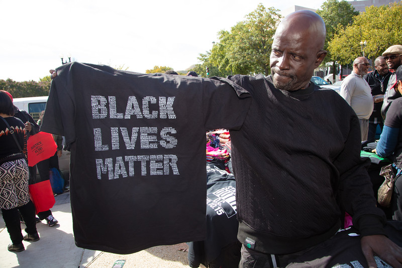 """""""Black Lives Matter"""" says this demonstrator. Thousands of black men and women from around the nation gathered to celebrate the 20th Anniversary of the Million Man March on the National Mall in Washington D.C. on Saturday October 10, 2015. Organized by Nation of Islam leader Louis Farrakhan, the theme of the rally was """"Justice or Else!"""", calling for policing reforms and changes in black communities."""
