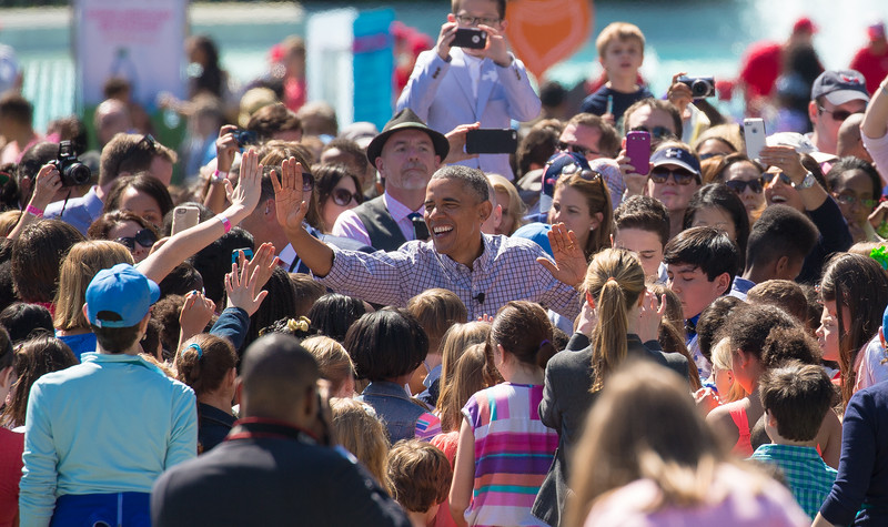 President Barack Obama greets members of the public during the annual White House Easter Egg Roll on the South Lawn.