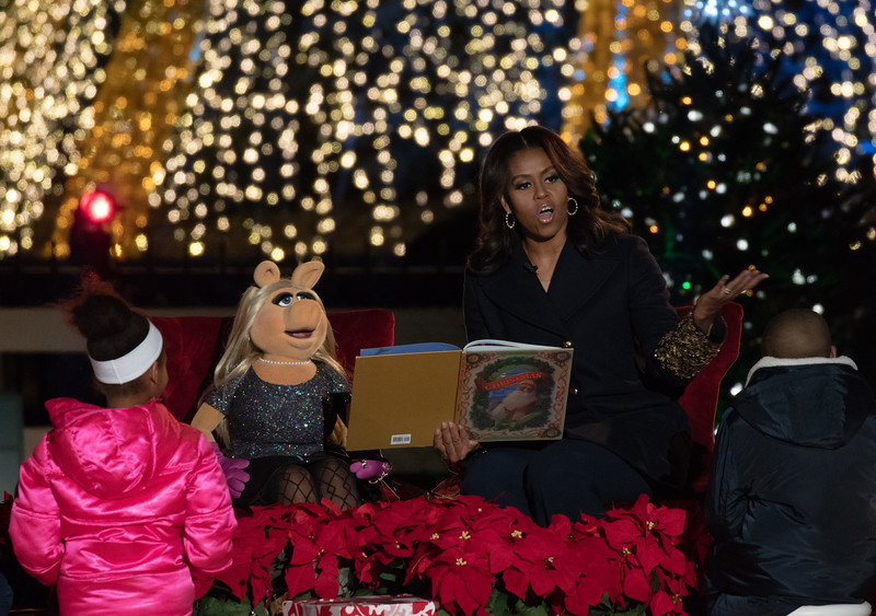 """First Lady Michelle Obama and Miss Piggy read """"A Night Before Christmas"""". President Barack Obama and the First Family led the lighting of the National Christmas Tree with a bevy of celebrity performers on the Ellipse at President's Park near the White House in Washington D.C. on Thursday, December 3, 2015. The 93rd annual lighting ceremony was presented by the National Park Service and the National Park Foundation."""