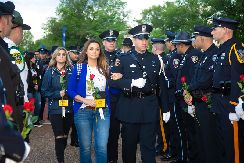 The wife of slain officer Cpl. Garrett Hull of the Ft. Worth Texas Police Department, and other survivor family members attend the Police Week Candlelight Vigil, on the National Mall on May 13. (Photo by Jeff Malet)