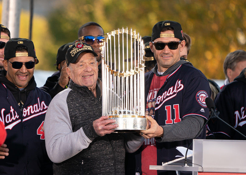 Original Washington Nationals owner Ted Lerner and first baseman Ryan Zimmerman hoist the Commissioner's Trophy during the Nationals World Series victory parade and celebration on Nov. 2, 2019. Photo by Jeff Malet.