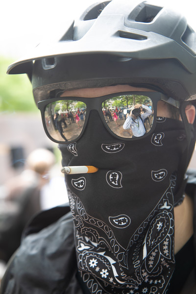Antifa demonstrator in photo was part of a group opposing the righ wing Proud Boys, Hundreds of D.C. police officers descended on the area around Washington's Freedom Plaza on Saturday, preventing antifascists from clashing with right-wing demonstrators during dueling rallies near the White House. (photo by Jeff Malet)