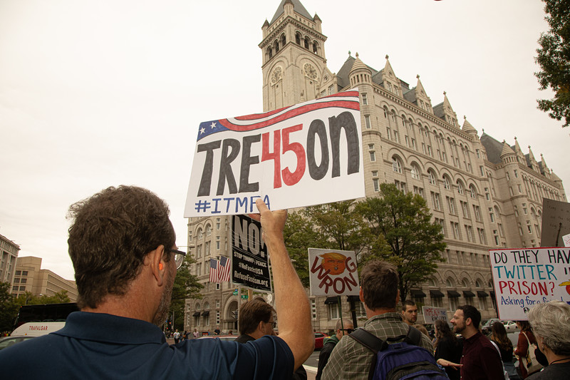 "Protesters demanding the impeachment of President Donald Trump, march from the White House to the Trump International Hotel in Washington, D.C. on Sunday, October 13, 2019. ""Tre45on"" reads the sign. (Photo by Jeff Malet)"