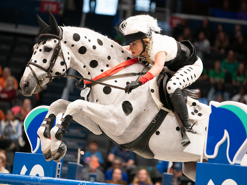 "Dressed as Cruella de Ville from Disney's ""One Hundred and One Dalmatians,"" Kristen Vanderveen, riding Bull Run's Faustino de Tili, earned the Best Costume Award in the $35,000 International Jumper Accumulator Costume Class.( Photo by Jeff Malet)"