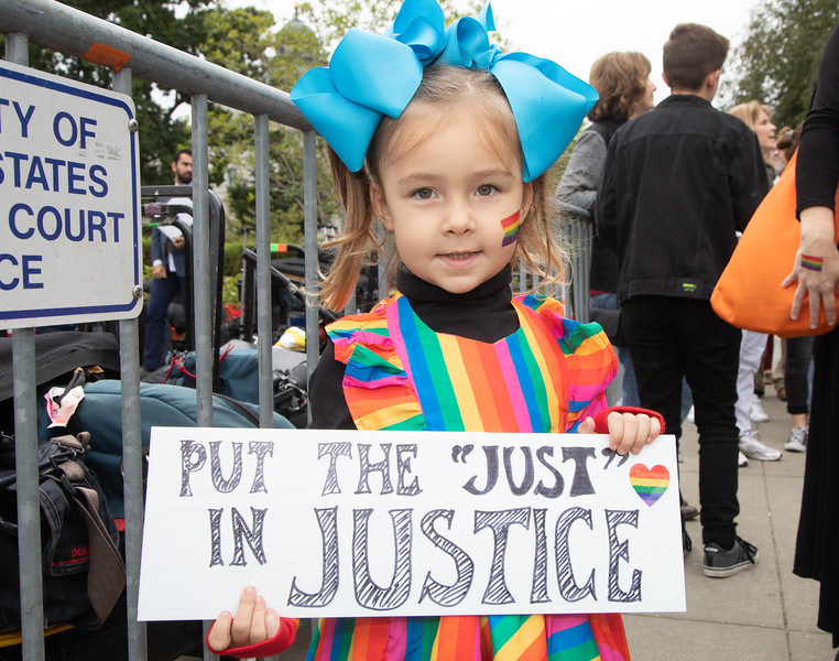 """Put the 'Just' in Justice"" says Emme, age 4. Gay and transgender activists demonstrated as the U.S. Supreme Court heard oral arguments in cases dealing with workplace discrimination based on sexual orientation, in Washington D.C. on Tuesday, October 8, 2019. (Photo by Jeff Malet)"