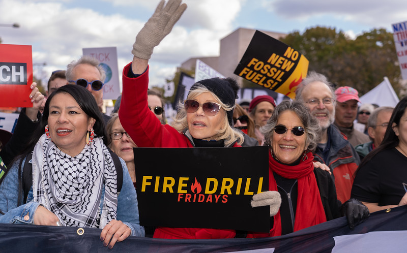"Actress Jane Fonda marches up Pennsylvania Ave. toward the White House during a climate rally Nov. 8, 2019  in Washington, D.C. Fonda, 81, has been leading protests at her ""Fire Drill Fridays"" for more than a month, and she has been arrested four times (though not this time).  (Photo by Jeff Malet)"