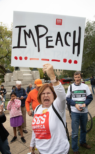 Protesters demanding the impeachment of President Donald Trump gather before marching to the White Housel, in Washington, D.C. on Sunday, October 13, 2019. (Photo by Jeff Malet)