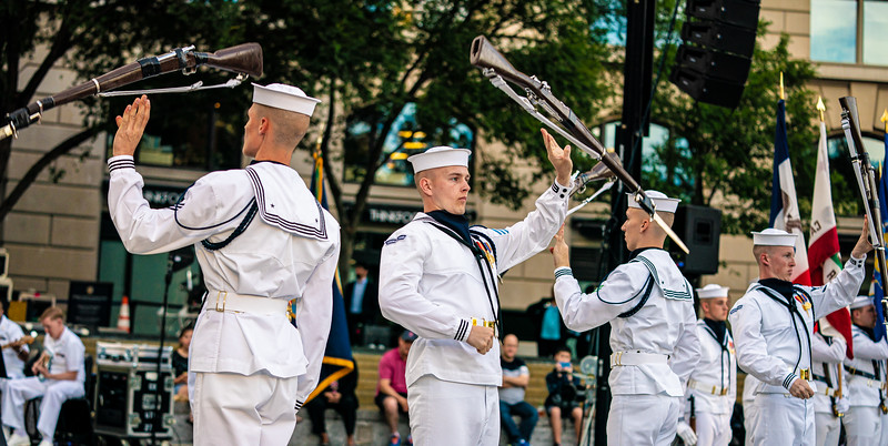 The United States Navy Ceremonial Guard Drill Team executes their flawless demonstration of close-order drill, coordination and timing. These sailors carry 1903 Springfield rifles, all with 10-inch fixed bayonets. June 11, 2019 at Navy Memorial Plaza in Washington D.C. (photo by Jeff Malet)