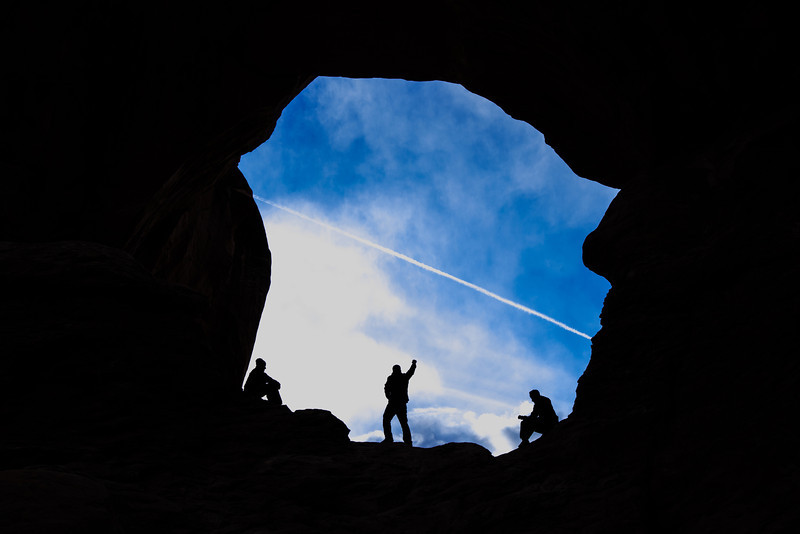 Hikers take a break inside Double Arch at Arches National Park. - Moab Utah <br /> Copyright 2014 - Thorpeland Photography