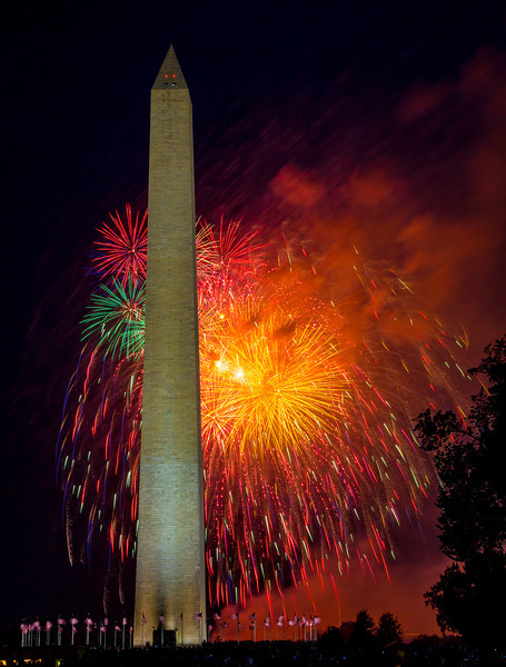 Spectacular fireworks light the sky behind the Washington Monument on July 4, 2012.