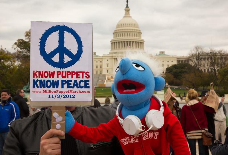 "Participants in the ""Million Puppet March,"" an event to support funding for public broadcasting, gathered at the Capitol Reflecting Pool on Saturday, November 3, 2012 in Washington D.C. just three days before the presidential election. It was a response to Mitt Romney's proposal during a presidential debate to reduce the national deficit in part by cutting funding for PBS and programs such as ""Sesame Street."" In photo, Jer Gallagher and his puppet Cooper of Seattle WA  (Photo by Jeff Malet)"
