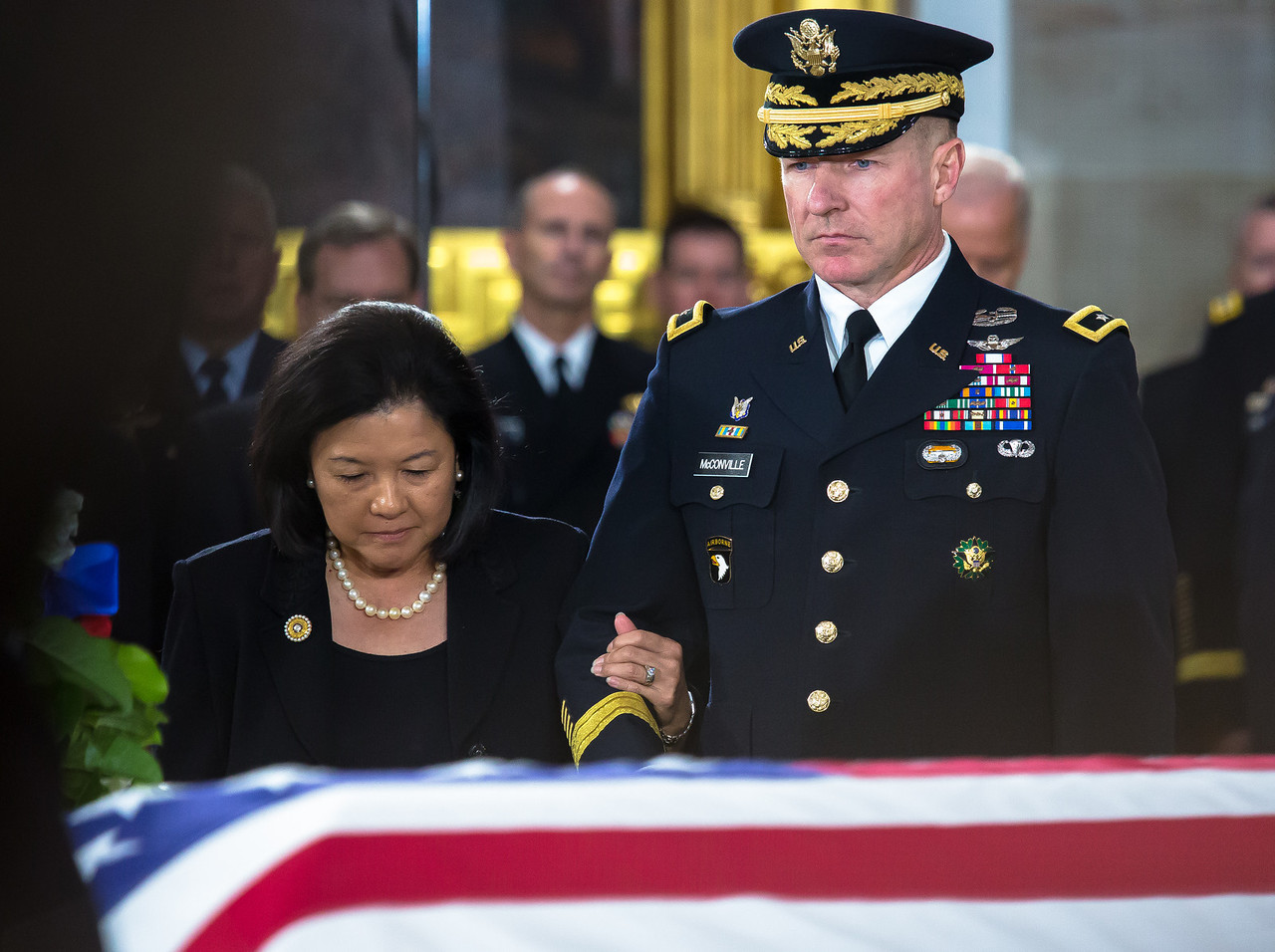 Irene Inouye, widow of the late Sen. Dan Inouye is escorted by Army Major General James McConville as Senator Inouye lies in state in the U.S. Capitol Rotunda in Washington D.C. on Thursday, Dec. 20, 2012. There, his colleagues and members of the public will pay their respects to the Senate's second-longest serving member. The Democrat from Hawaii was a Medal of Honor recipient for valor in World War II. He died Monday from respiratory ailments at age 88. Lying in state is an honor typically reserved for presidents, bestowed only 31 times since the 1800s. According to tradition, Inouye's casket sat underneath the Capitol dome, atop the Lincoln catafalque, the platform built in 1865 to support Abraham Lincoln's casket when that president's body lay in state.  (Photo by Jeff Malet)
