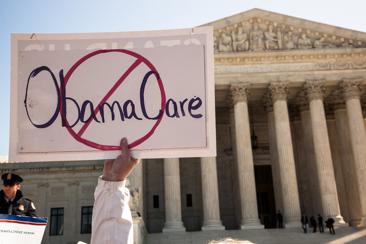 Opponents and supporters of the health care reform law clashed outside the U.S. Supreme Court Tuesday, March 27, 2012. The Court Held Hearings on the Constitutionality of the President's Health Care Reform Bill.