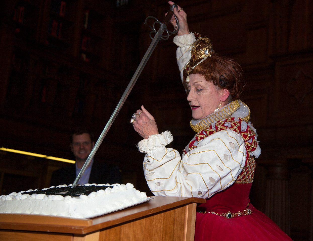 Queen Elizabeth I portrayed by Penelope Rahming cuts Shakespeare's birthday cake at the Folger Shakespeare Library in Washington DC.