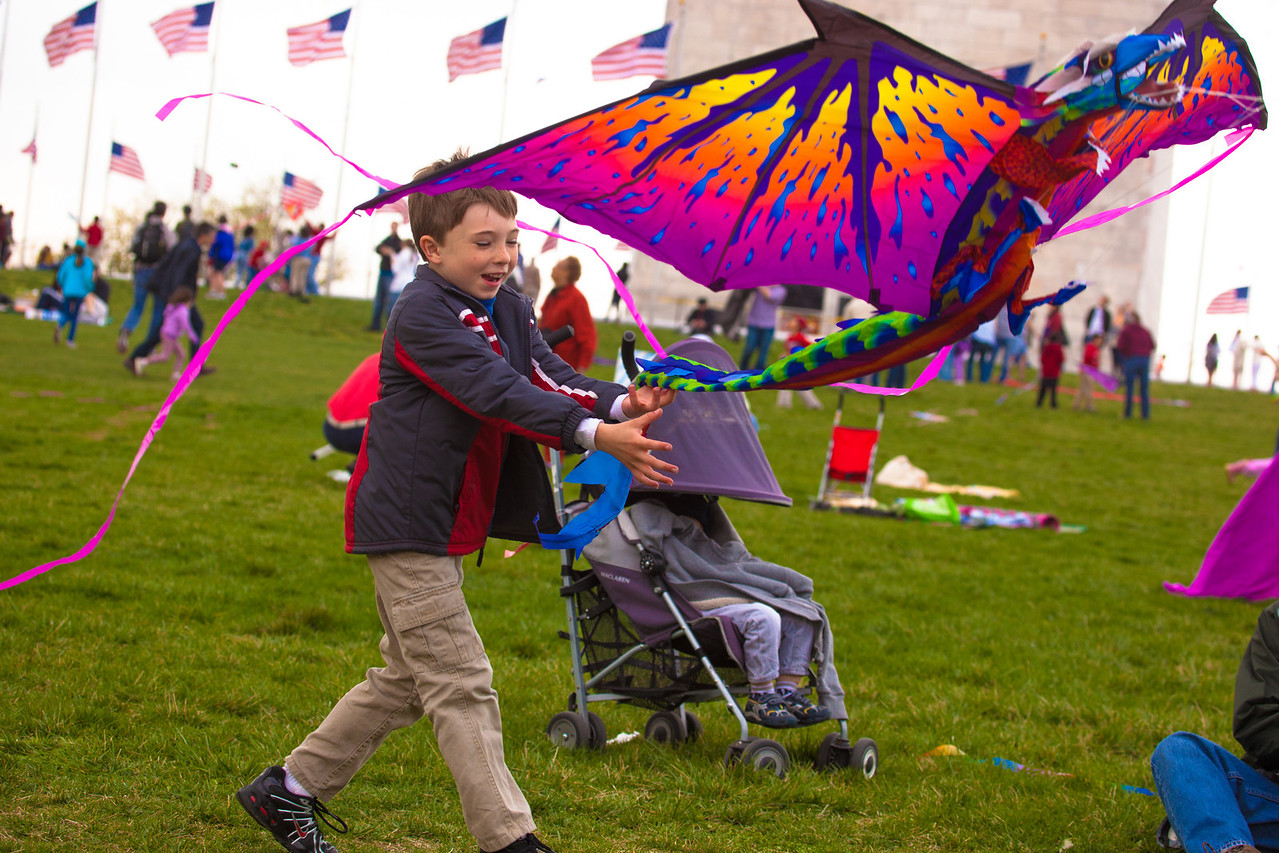 Ryley O'Quinn of Raleigh NC launches his kite. On a perfectly windy day on Saturday, March 31, 2012, families enjoyed the Blossom Kite Festival surrounding the Washington Monument.